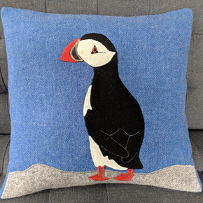Puffin cushions with light blue backgrounds