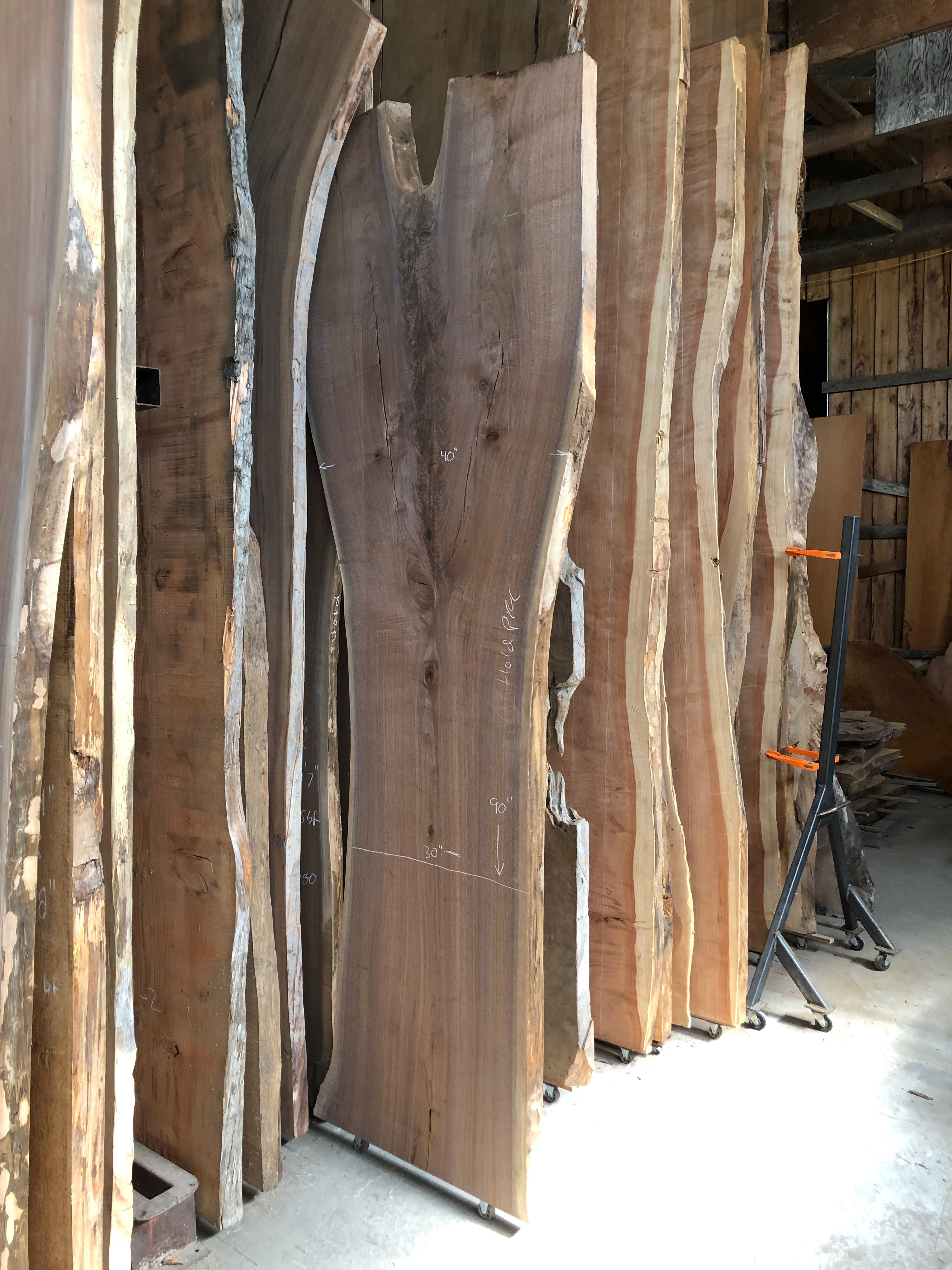 live-edge-wood-slabs-stacked