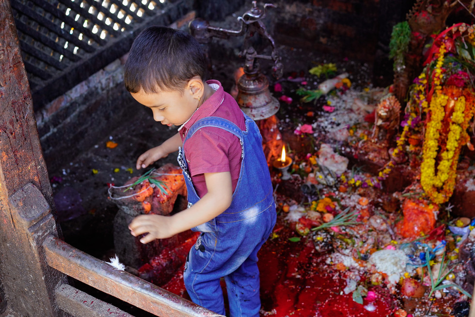 This young boy, followed its curiosity and went inside the temple on its own and almost slip.