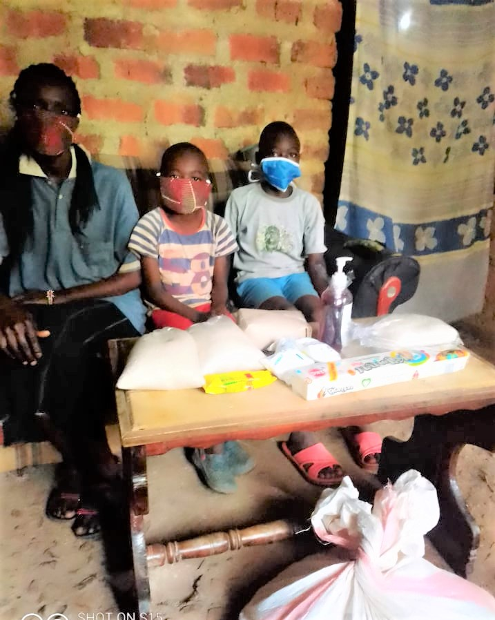 Indakwas bring masks and food to a village family