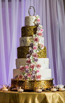 6 tier wedding cake with sugar flowers