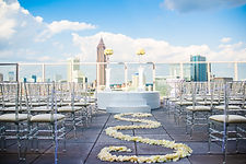 All white wedding ceremony with floral aisle