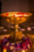 Purple wedding reception design with flowers and candles