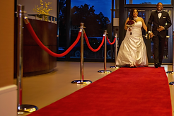 Red carpet and step and repeat at wedding reception Alakija Studios