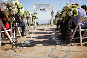 Malibu, CA wedding with petals down aisle and ceremony draping