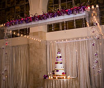 Purple 200 Peachtree wedding reception cake display clear acrylic chuppah at 200 Peachtree Southern exchange
