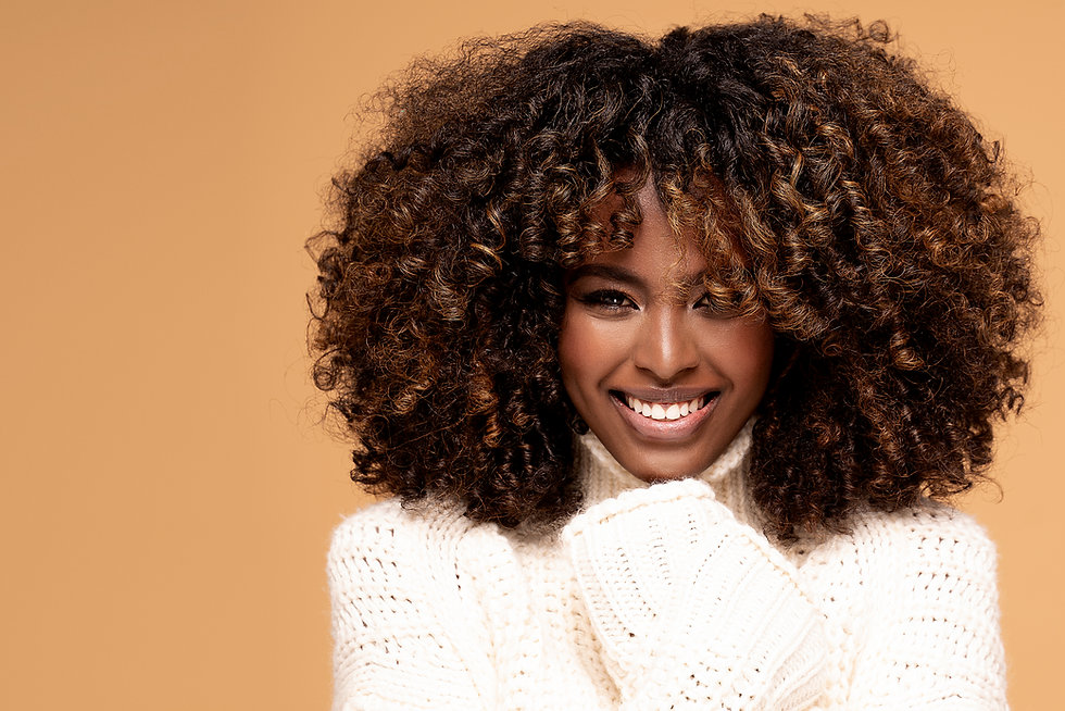 Happy beautiful african girl with afro h