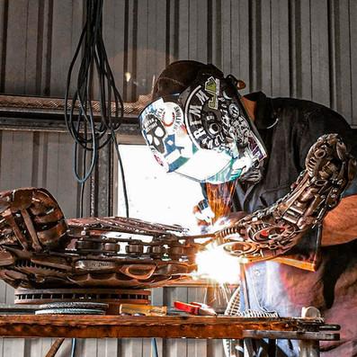 barefooted-welder-scrap-metal-art-sculpt