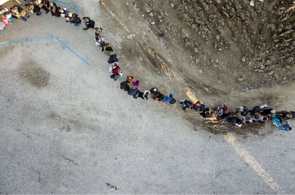 Trans Europe Migration (2015) A visual depiction of human migration along the Balkan Route.  Idomeni, Greece. Refugees and migrants in line to enter the emergency shelter on the border between Greece and Macedonia. Around 6000 people arrived on that day in the Idomeni camp, mostly by bus from Athens, after having reached Greece with small boats from Turkey. In the camp, clothes, medical check-ups and food are provided by NGOs, international organizations and volunteers. Refugees and migrants then continue their journey by foot, entering Macedonia, before going by a train to the Serbian border.