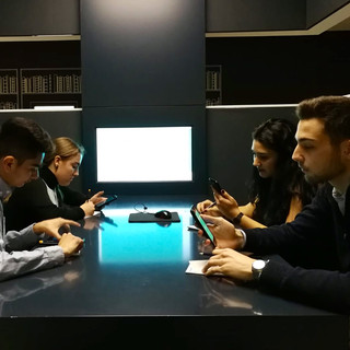 Students using the provided interactive technology during the EU Parlamentarium role play game.