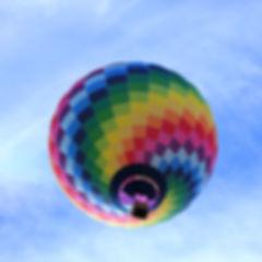 hot-air-balloon-flying-under-blue-sky-du