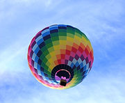 hot-air-balloon-flying-under-blue-sky-du