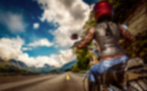 Biker girl rides a motorcycle in the rai