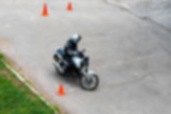 Man is practicing driving a motorcycle i