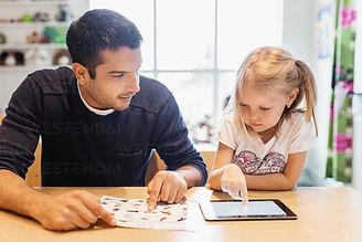 mid-adult-male-teacher-looking-at-girl-u