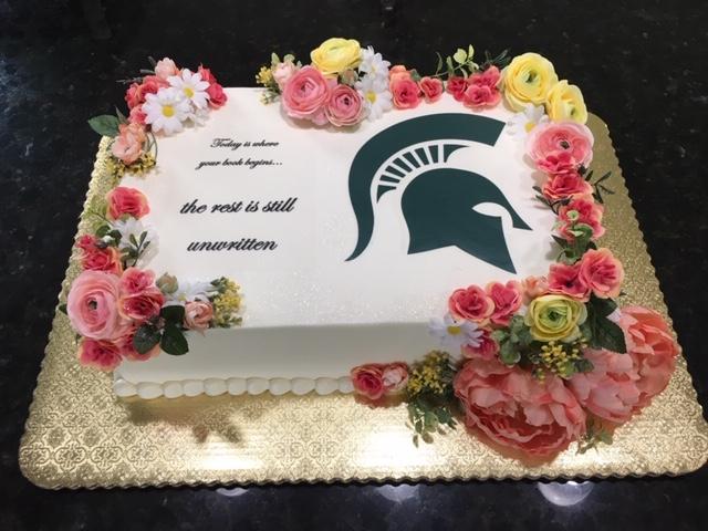 MSU Spartan and Flowers