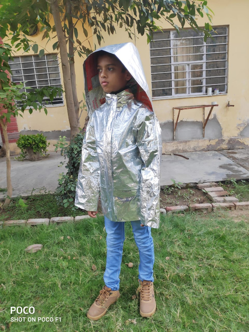 Protective gear with hood made out of waste MLPs by Vijay