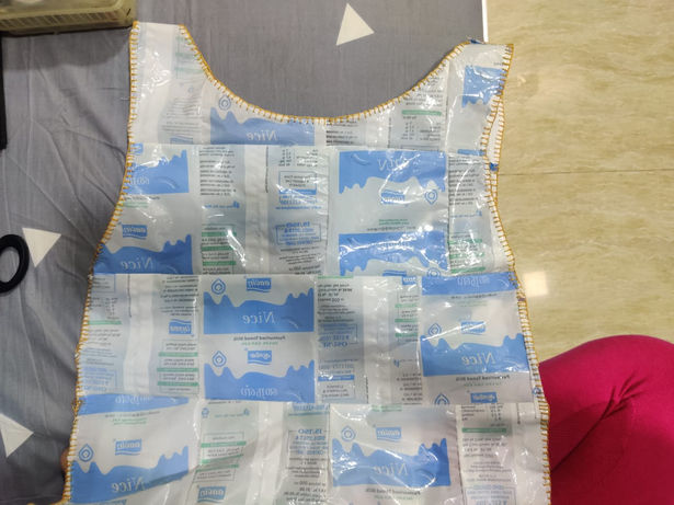 crop top made out from waste milk packets by Roanshi