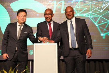 Minister of Public Utilities, Senator Robert Le Hunte, is flanked by TSTT's CEO Dr. Ronald Walcott and Huawei T&T's CEO, Jeff Jin, as 5G is officially launched in T&T.