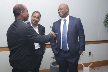 Charles Carter engages TSTT's CEO, Dr. Ronald Walcott and General Manager Shared Services, Gerard Cooper before the launch of 5G.