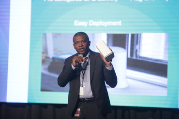 TSTT's Chief Technology Officer, Hassel Bacchus, displays the 5G CPE modem during his presentation