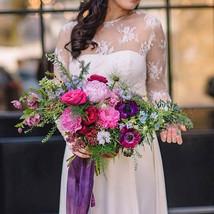 Bold bright flowers for wedding  - image by Amanda Dumouchelle