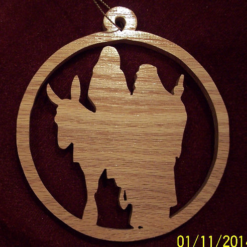 Custom Scroll Art by Joshua Lacey. Joseph and Mary on donkey Christmas ornament made from red oak.