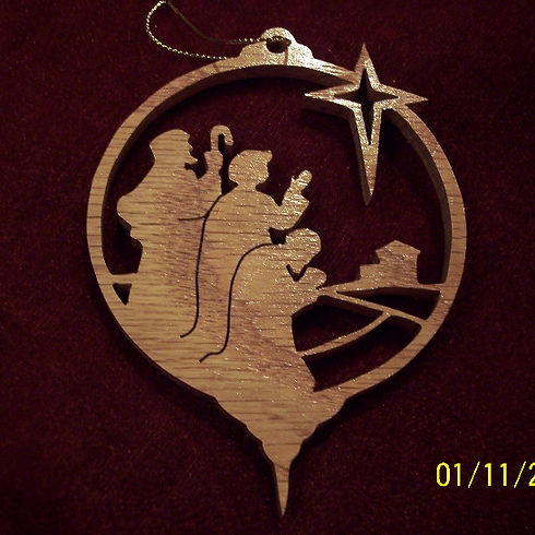 Custom Scroll Art by Joshua Lacey. Three wise men Christmas ornament made from red oak.