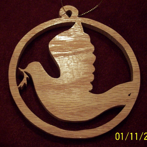 Custom Scroll Art by Joshua Lacey. Dove Christmas ornament made from red oak.