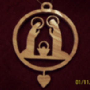 Custom Scroll Art by Joshua Lacey. Joseph, Mary, and baby Jesus Christmas ornament made from red oak.