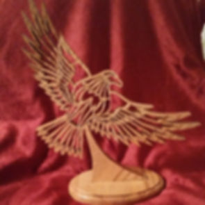 Custom Scroll Art by Joshua Lacey. Eagle desktop stand made from red oak.