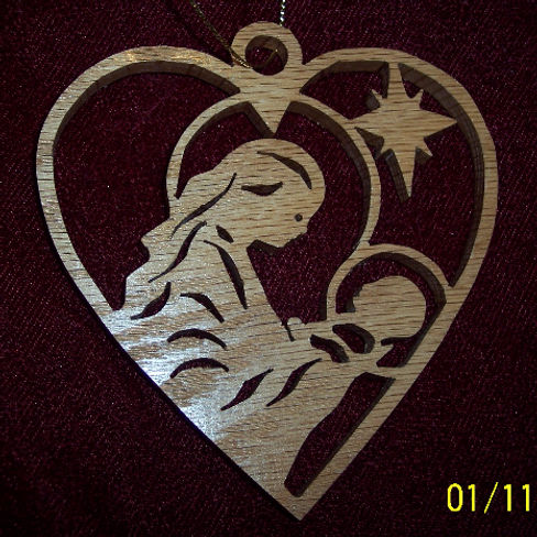 Custom Scroll Art by Joshua Lacey. Mary and baby Jesus Christmas ornament made from red oak.