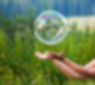 bigstock-hand-catching-a-soap-bubble-269