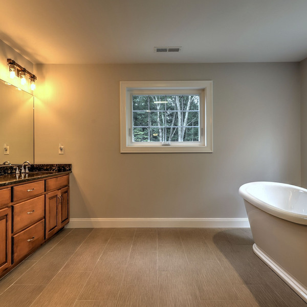 Custom Bathroom Design with white tub
