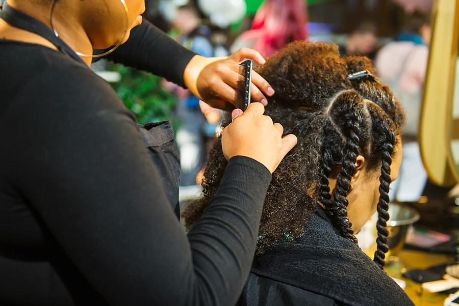 Licensed Hair Braider doing a woman's braids