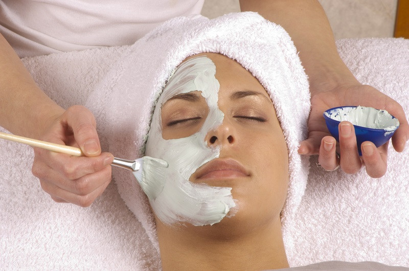 Esthetician Applying Organic Facial Mask in Woman's Face in Orlando fl