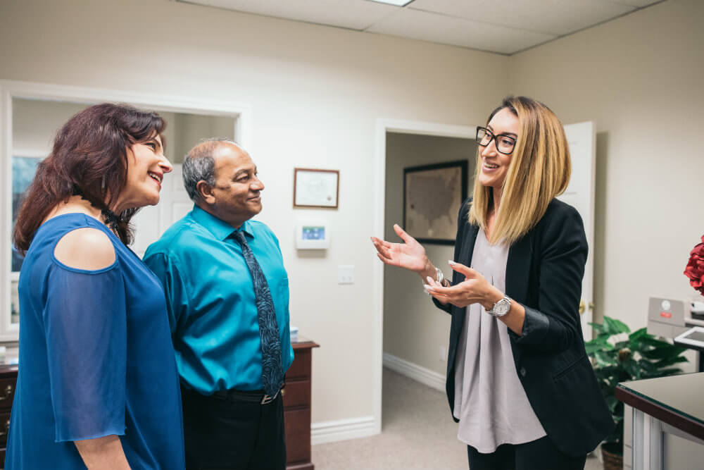 taleena greets clients