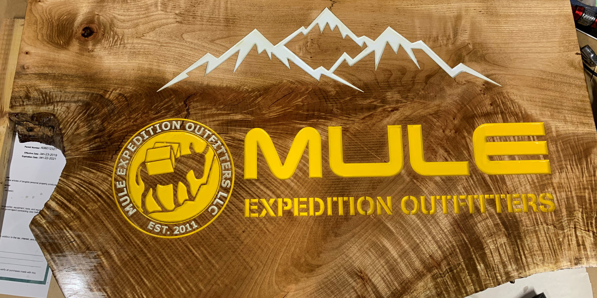 Mule opened a new store so I got to make a new sign for them. Tiger Maple epoxied cracks and paint.