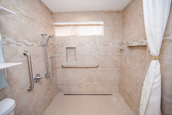 Wide shower for use with a reclining wheelchair