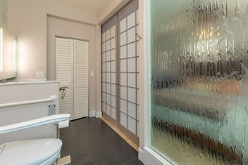 Use of etched glass wall to increase space