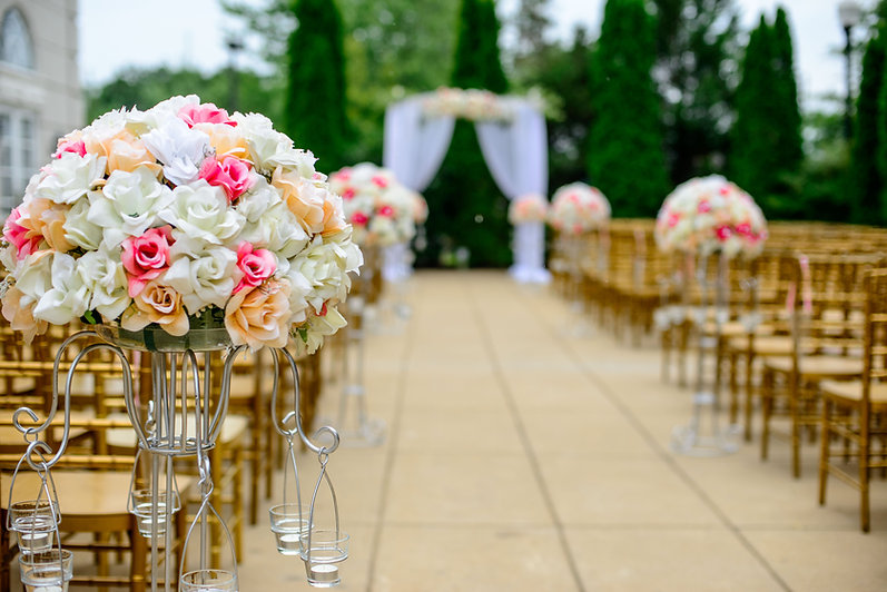 Wedding aisle and canopy with gold chairs.
