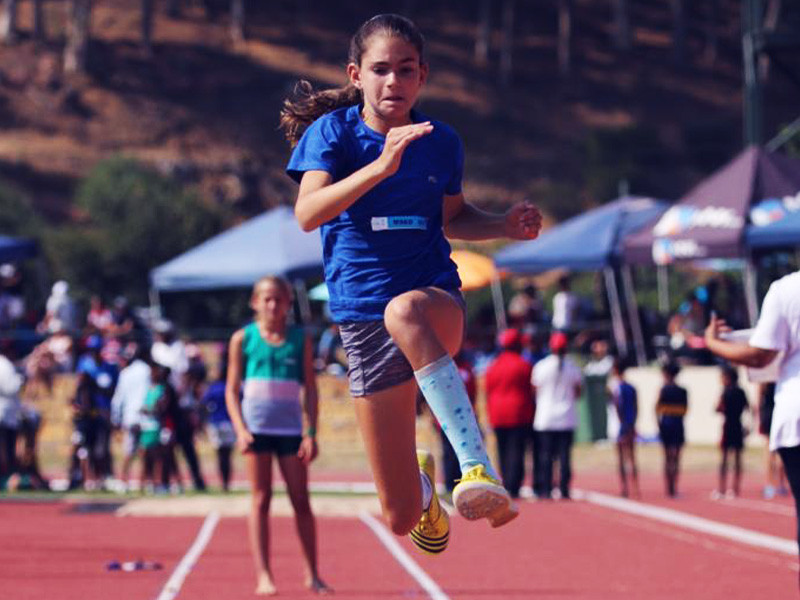 Demi leaping to first place in u12 long jump at WPPSAC