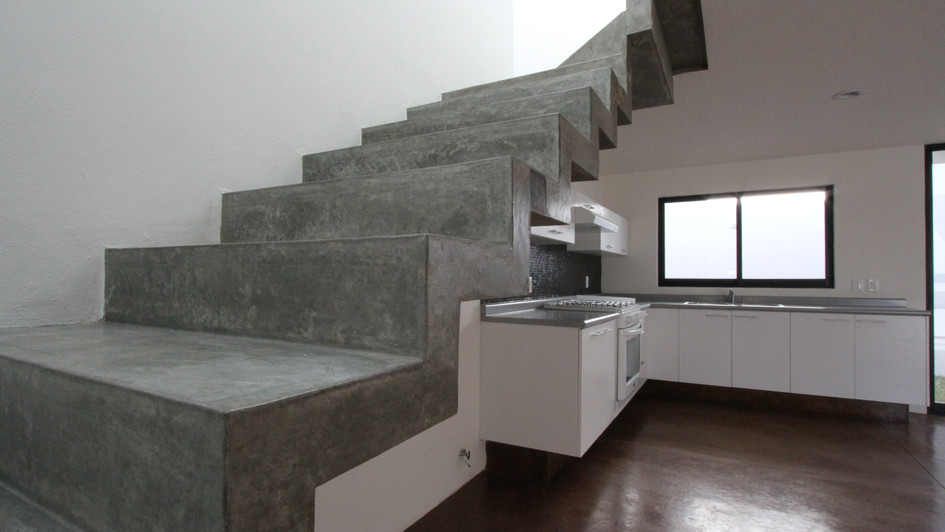 STAIRCASE AND KITCHEN VIEW