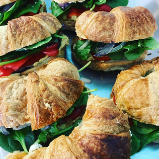 Roasted Veggie Sandwich on a Croissant with Hummus, Dill Cream Cheese and Spinach