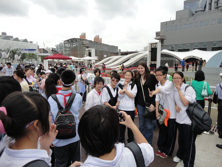 In this image, Erika is at the international EXPO in Shanghai, in 2010, surrounded by a group of Chinese students that requested to take a picture with her because she is a foreigner and different from them and the people they were used to seeing.