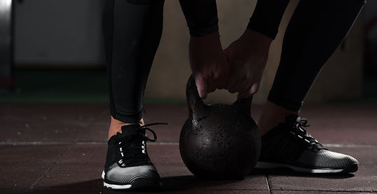 Man with Kettle bell training for strength and conditioning