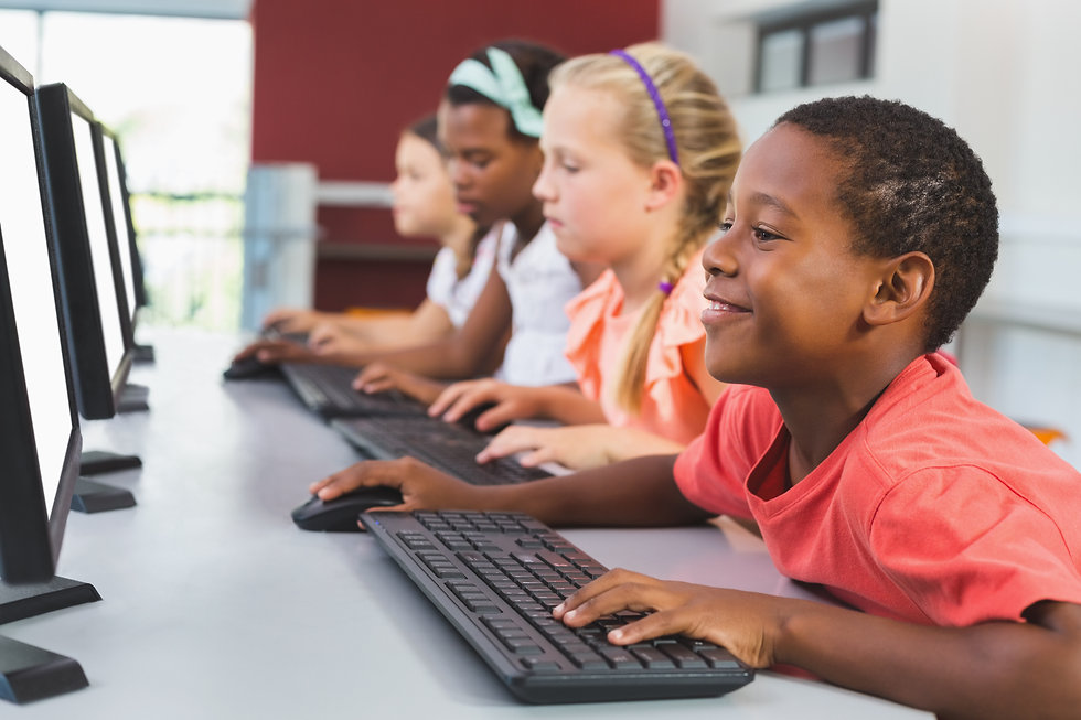 school-kids-using-computer-in-classroom-