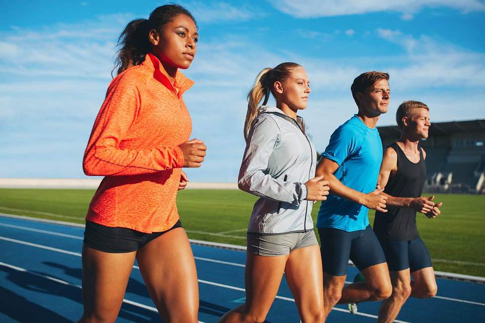 diverse-sports-person-running-on-racetra