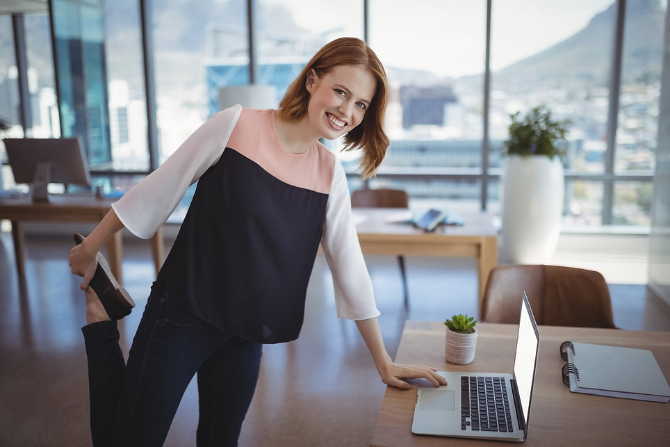 portrait-of-smiling-executive-using-lapt