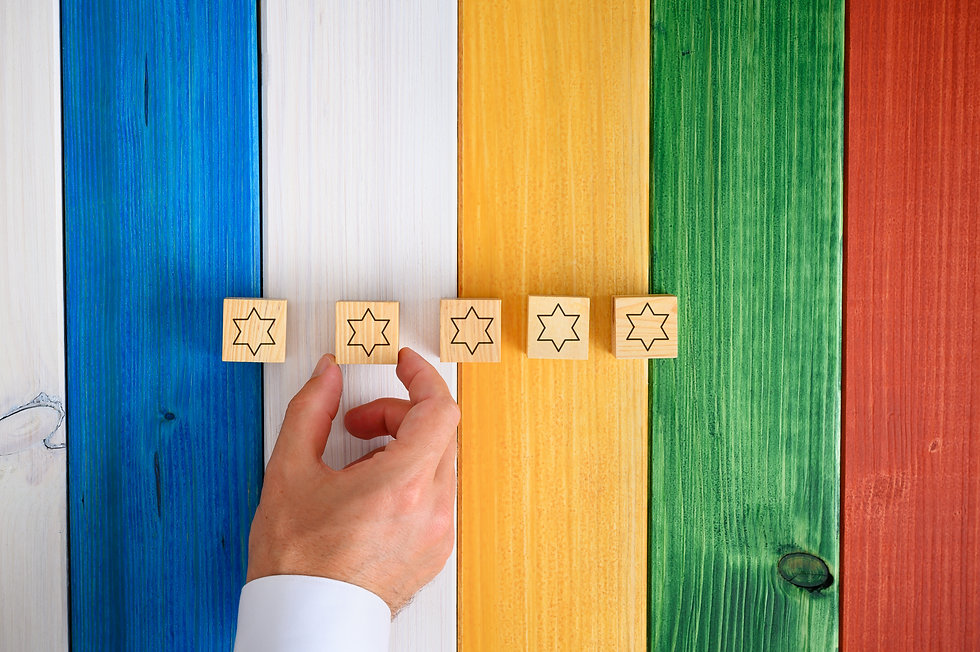 man-placing-five-wooden-cubes-with-stars